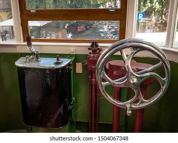 LISBON, PORTUGAL - SEPTEMBER 8, 2018: view of the interior of Lisbon famous trams called Funicular showcasing the driver station.