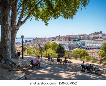 LISBON, PORTUGAL, SEPTEMBER 8, 2019: view of Lisbon in Portugal showcasing one of its several high point observatories with locals and tourists appreciating the nice weather.