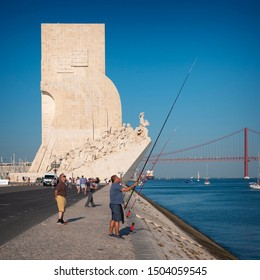 LISBON, PORTUGAL - SEPTEMBER 8, 2019: view of Lisbon in Portugal showcasing one of its most famous landmarks, Padrao dos Descobrimentos with locals and tourists passing by.