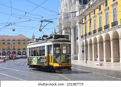 LISBON, PORTUGAL - SEPTEMBER 9, 2013: Yellow tram on Praca do Comercio. Yellow tram (funicular) is the symbol and the tourist attraction of Lisbon.