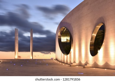 Lisbon, Portugal - September 9, 2016: Champalimaud Center for the Unknown - Biomedical research center, building exterior and paved walkway illuminated at dusk, Lisbon Portugal Europe.