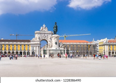 Lisbon, Portugal, September 9, 2018: Comércio Plaza with tourists and construction work with two crane on backgrounds