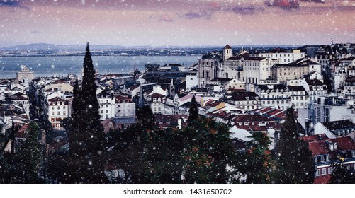 Lisbon, Portugal snowy scene cityscape overlooking Baixa downtown area. Visible landmarks include: Rua Augusta Triumphal Arch, Rossio, Santa Justa Elevator and Chiado with Tagus River at background