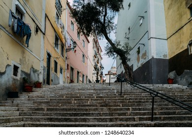 Lisbon, Portugal. Stone stairs with railings among colourful old houses in Alfama district.