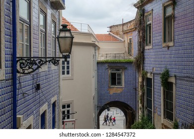 Lisbon, Portugal, winter, February 2018. Azulézhu, wall, lantern. Blue, purple color. Tourists in the arch.