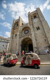 Lisbon, Spain - 20 July 2017: View on Cathedral of Lisabon with small taxi cabs in front
