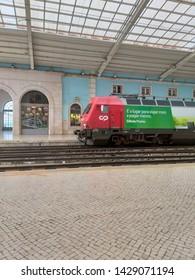Lisbon/Portugal - June 20, 2019: train at the Santa Apolónia trainstation with a blue background
