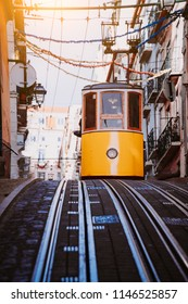 Lisbon's Gloria yellow funicular drives down the street. Lisbon, Portugal. West side of the Avenida da Liberdade connects downtown with Bairro Alto