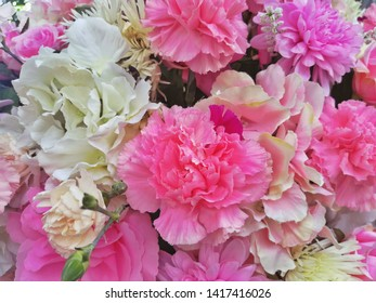 The Lisianthus flowers of background. The pink flower of background. The white flower.