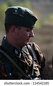 "LISICHANSK -SEPT 30 : members of Zaporozhye history club ""Shield of Fatherland"" wears historical German uniform during historical reenactment of WWII, September 30, 2012,Lisichansk, Lugansk, Ukraine"