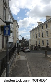Liskeard, Cornwall - Pike street, looking down the hill towards Pipe Well, with bunting, blue sky and white clouds
