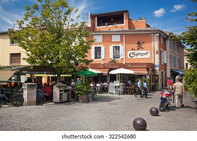 L'ISLE-SUR-LA-SORGUE, FRANCE - AUGUST 14, 2015: People sitting at restaurants and cafes terraces.