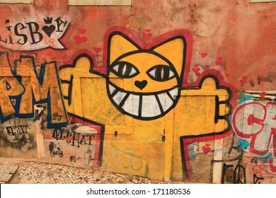 Lissabon, Portugal, November 5, 2013. Anonymous graffiti image shows merry cat ready to embrace you. Graffiti is located in old city.