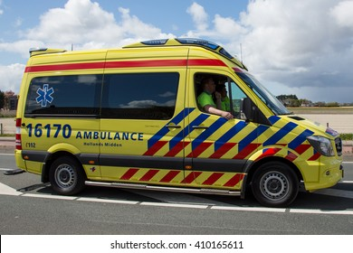 Lisse, NETHERLANDS - 23 APRIL 2016:  slowly driving dutch ambulance vehicle