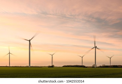 Lissett, Yorkshire, UK. Modern wind turbines in field, previously RAF WW2 airfield, at sunset on a fine winter evening in Lissett, near Beverley, Yorkshire, UK.
