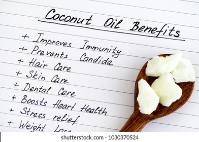 List of Coconut Oil Benefits with wooden spoon with coconut oil. Close-up.
