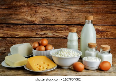 List of dairy products on a dark wood background. toning. selective focus
