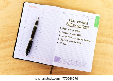 List of New Year's Resolution on Notepad - New Year Concept