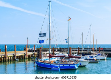 LIST PORT, SYLT ISLAND - SEP 6, 2016: sailing boats anchoring in small port of List village on sunny summer day, Germany.