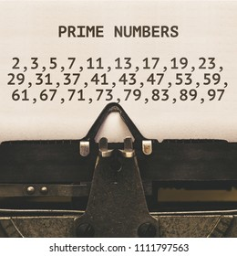 List of Prime Numbers below 100 on paper in vintage type writer machine from 1920s closeup with paper