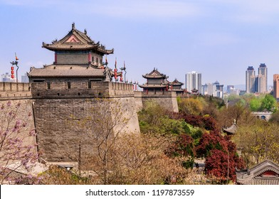 Listed historical city wall of the old imperial city of Xi'an - The fortification from the 14th century is one of the best preserved fortesses in China