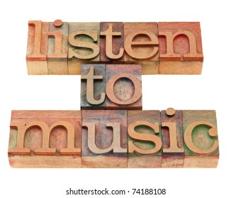 listen to music inspirational suggestion in vintage wood letterpress printing blocks, isolated on white