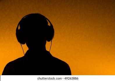 Listen to the Music - silhouette of man with earphones (back light)