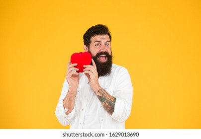 Listen to your heart. Health Check helps understand risk factors for heart disease and estimate how likely have attack or stroke next years. Man bearded hipster hold red heart toy. Medicine concept.