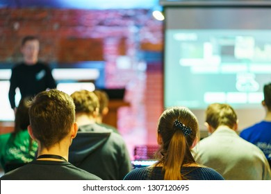 Listeners trained audience. Young people audience listen speaker during a lecture, training or presentation. Modern office workers improve skills. Presentation performance. Soft focus.