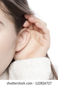Listening ear of a little child over a white background