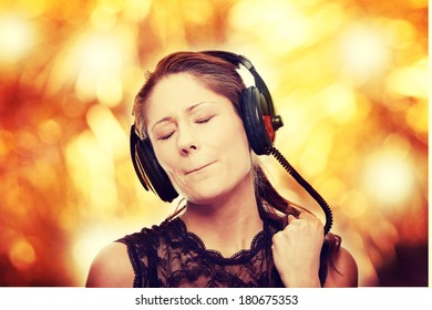 Listening to the Music, young caucasian beautiful woman with headphones, isolated on white background