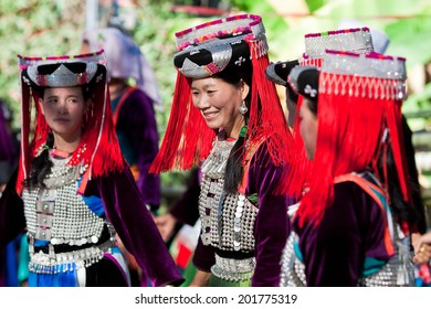 LISU, THAILAND - FEBRUARY 7: Young women in national costumes during Spring Festival (Chinese New Year) in village of Lisu, province of Mae Hong Son, Thailand, February 7, 2014