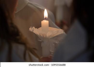 Lit candle burning on an isolated background, catholic church mass
