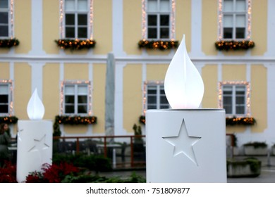 Lit candle on a big outdoor Christmas wreath in Upper Town Zagreb, Croatia. Selective focus.