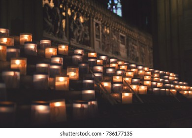 Lit Candles inside church Notre Dame de Paris, France