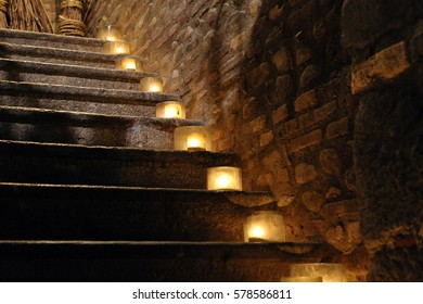 lit candles on the old ladder. farmhouse. Scale steps