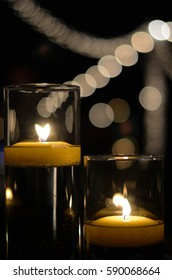 Lit candles at a social event.
