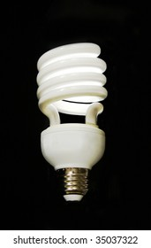 Lit CFL Light Bulb Without Lettering isolation on black