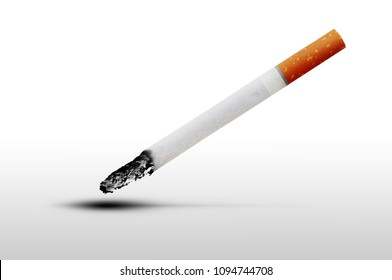 Lit cigarette with a filter on a light background