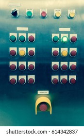 lit lights and panel control dials push button on manufacturing machinery or plant process