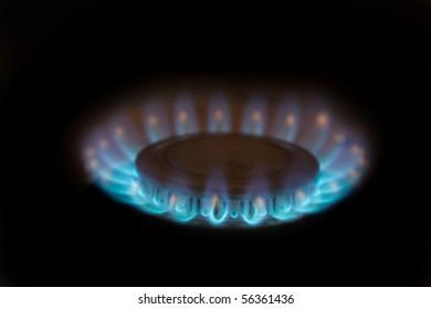 Lit propane burner throwing blue flames