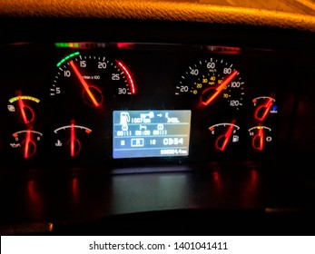 Lit truck dashboard at night