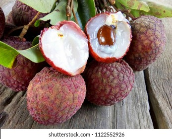 litchi, lichee, lychee, or lichi, Litchi chinensis on old rustic wood background with copy space