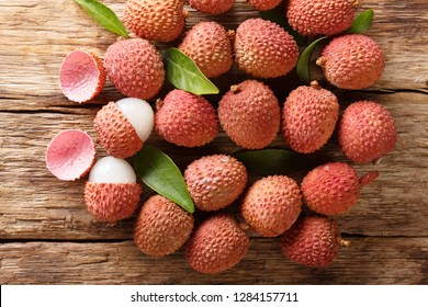litchi, lichee, lychee, or lichi, Litchi chinensis on old rustic wood background with copy space. horizontal top view from above