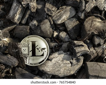 Litecoin coin lies on coal. Mining litecoins. Energy for mining cryptocurrency.