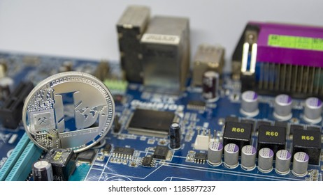 litecoin coin on the computer mainboard