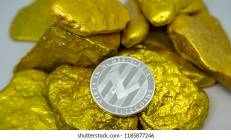 litecoin coin on gold chunks