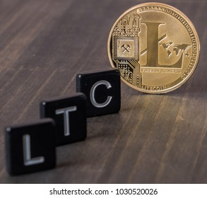 Litecoin cryptocurrency with letters LTC on wooden table top