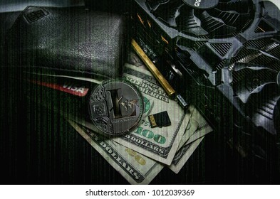 Litecoin leaning on leather wallet on top of dollar bills  by  a GPU and SD memory card chip