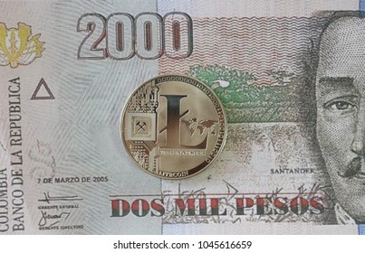 Litecoin on Colombian Pesos Banknotes Background , Cryptocurrency concept